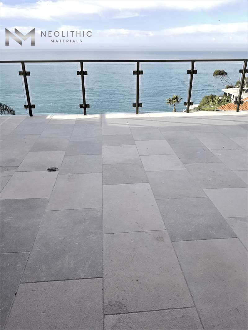 Close up look of Reclaimed Stone Dalle de Montresor installed in terrace with amazing ocean view