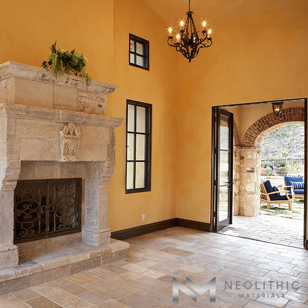 High Quality Reclaimed Antediluvian Limestone used in the flooring of an empty classic living room