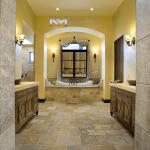 Reclaimed Antediluvian Limestone used in the flooring of a classic bathroom