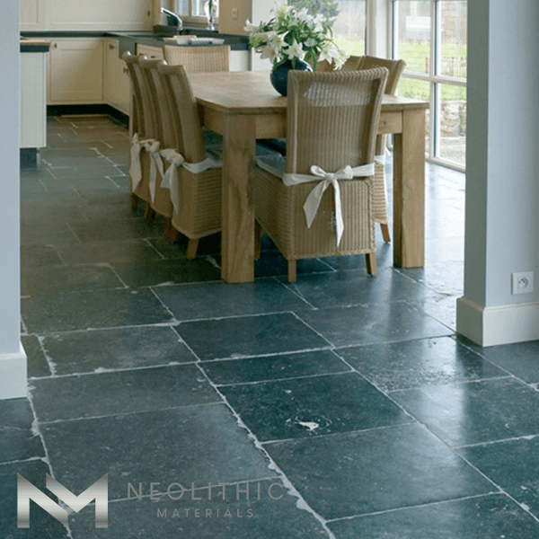 Reclaimed Petit Granit used in flooring of a beautiful dining room