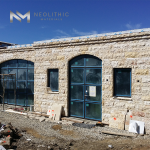 Cladding Coarse Tile installed in outdoor walling of the whole classic house with a glass doors and windows